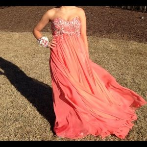 Coral strapless gown.